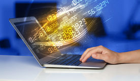 Man typing on modern notebook with number technology data coming Royalty Free Stock Photos