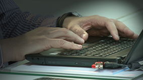 Man typing on the notebook keyboard. Office man working on laptop stock footage