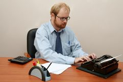 Man typing on Old Typewriter Royalty Free Stock Image