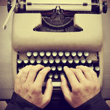 Man typing on an old typewriter Royalty Free Stock Photography