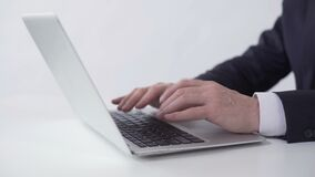 Man typing and sending email to business partner on laptop, working in office. Stock footage stock video