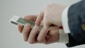 Man is typing on smart phone. Close up of male hands texting a  phone message by one finger stock video footage
