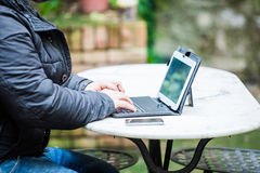 Man typing on a tablet Royalty Free Stock Photo