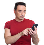 Man typing text message on mobile phone. Isolated. Typing text message. man standing on white isolated background and holding mobile phone Stock Images
