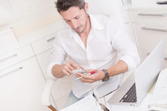 Man typing text message in office Stock Photo