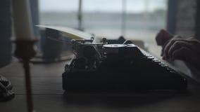 Man typing text on old typewriter stock video footage