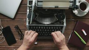 Man typing on typewriter. Cropped shot of typist working on old typewriter at his workplace stock video footage