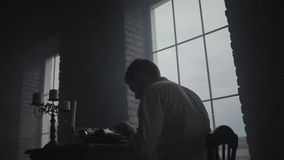 Man typing on a typewriter studio in loft studio stock video