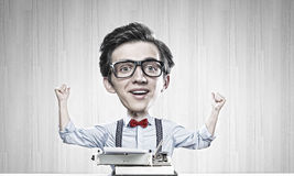 Man typist. Young funny man writer with big head Royalty Free Stock Photos