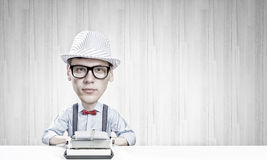 Man typist. Young funny man writer with big head Stock Photos