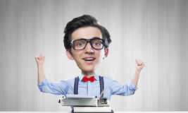 Man typist. Young funny man writer with big head Stock Photo