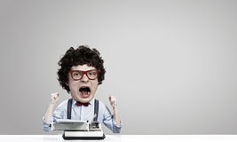 Man typist. Young funny man writer with big head Stock Image