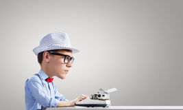 Man typist. Young funny man writer with big head Royalty Free Stock Images