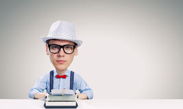 Man typist. Young funny man writer with big head Royalty Free Stock Photo