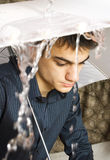 Man with umbrella. Portrait of caucasian man with white umbrella Stock Photo