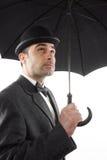 Man with an umbrella Stock Image