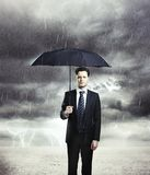 Man with umbrella Stock Images