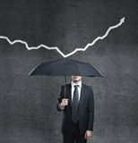 Man and arrow. Man with umbrella and arrow Stock Images