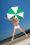 Man with umbrella on a beach royalty free stock photo