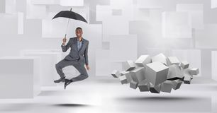 Man with umbrella floating next to geometric surreal cubes. Digital composite of Man with umbrella floating next to geometric surreal cubes royalty free stock photography