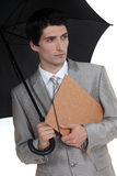 Man with umbrella and folder Royalty Free Stock Images