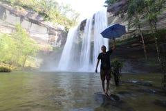 Man umbrella at Huai Luang waterfall Stock Photos