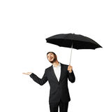 Man with umbrella looking up. Smiley businessman with umbrella looking up. isolated on white background Royalty Free Stock Images