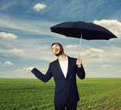Man with umbrella looking up Royalty Free Stock Image