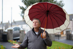 Man with umbrella outside in the rain Royalty Free Stock Photography