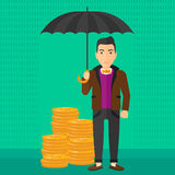 Man with umbrella protecting money. Stock Photo