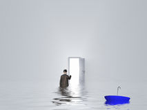 Man with umbrella in pure white room. With open door Royalty Free Stock Photo