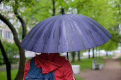 Man with umbrella with rain drops Stock Photo
