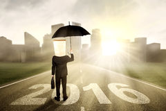 Man with umbrella standing on the road Stock Images
