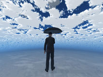 Man with umbrella under cloudy sky Royalty Free Stock Image