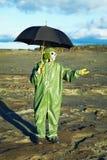Man with umbrella waiting for acid rain. Man in suit and gas mask with umbrella waiting for acid rain Stock Photos