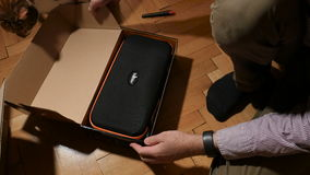 Man unboxing beholder DS1. PARIS, FRANCE - CIRCa 2016: Man unboxing Amazon Prime box with new 3-axis handheld camera stabilizer made by IKAn Beholder DS1 stock footage