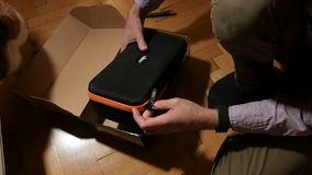Man unboxing beholder DS1. PARIS, FRANCE - CIRCa 2016: Fast motion timelapse of man unboxing Amazon Prime box with new 3-axis handheld camera stabilizer made by stock video footage
