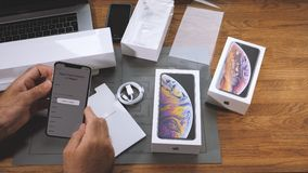 Man unboxing iPhone Xs Max Xr quick start settings language. PARIS, FRANCE - SEPTEMBER 21, 2018: Apple fan boy unboxing latest new Apple iPhone Xs Max and Xs stock video footage