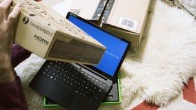 Man unboxing new gamer Razer Blade Stealth laptop sent by Amazon windows 10 installations. PARIS, FRANCE - CIRCA 2017: Man unboxing new gamer professional stock video