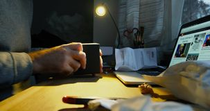 Man unboxing unpacking the Braun clock. PARIS, FRANCE - CIRCA 2017: Curious man unboxing unpacking the postage envelope containing the Braun Luxury designer stock footage
