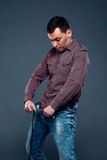 Man unbuttoned pants and looking at his penis Royalty Free Stock Photos