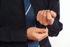 Man unbuttons his sleeve black shirt closeup Stock Photo
