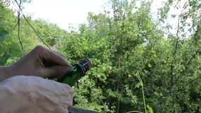 Man uncorking a bottle of champagne in the open air. Man uncorking a bottle of champagne in the open  air stock footage