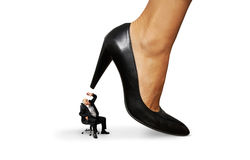 Man under big female heel Stock Photo