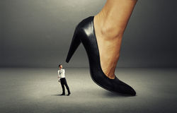 Man under big heel Royalty Free Stock Images