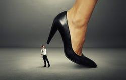 Man under big heel Royalty Free Stock Images