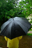 Man under the  black umbrella while rainig Royalty Free Stock Photo