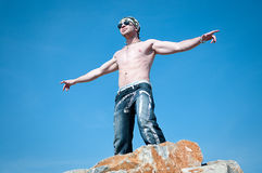 Man under blue sky. Free and relax of man under blue sky Stock Photos