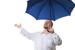 Man under blue umbrella. Man in white shirt under dark blue umbrella, isolated on white background Royalty Free Stock Image