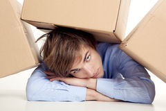 Man under boxes Royalty Free Stock Image